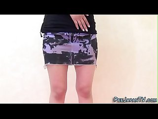 Upskirt asian teenager pissing