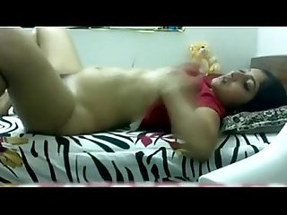Busty indian girl masturbates her hairy pussy with red thing