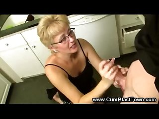 Intense handjob from mature lady for young guys cock