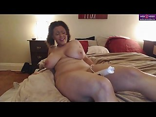Busty chick toying with her pussy
