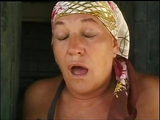 Old woman fucked in the farm of shame