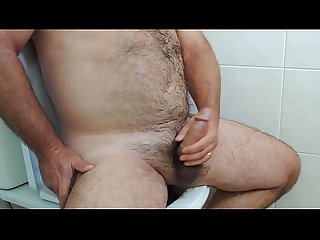 Hairy masturbating on the toilet