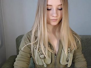 Pretty blonde teen from www viewcamgirls com flashes tits on webcam