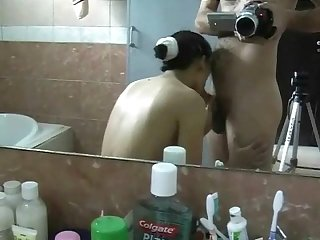 Mature Chinese milf blowjob in bathroom