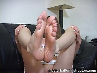 Jerk off teacher displays her feet to show her footjob skills