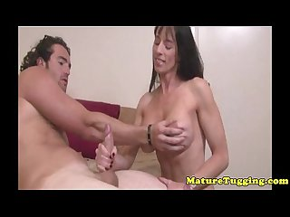Handjob milf gets cumshot over her bigtits