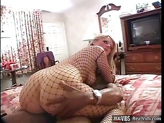 Blonde in fishnet sucks and fucks black dick