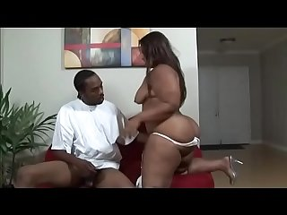 Fat whore Amber Swallows with big buckets fucks in all poses with a black guy