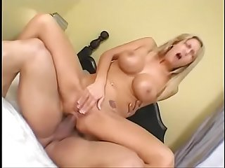 Sexy slut with big tits banged by a black cock