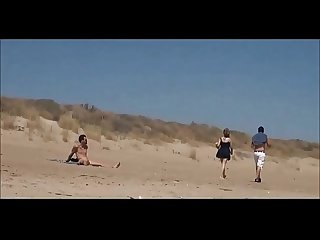 Couple split by strangers and fuck her on nude beach