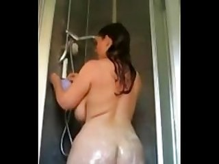 Curvy wife with saggy tits taking a shower