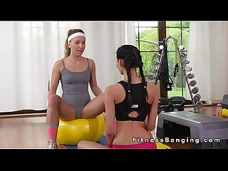 Lesbian fitness trainer getting fingered