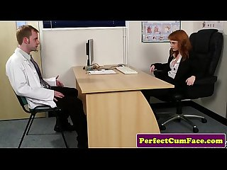 Stockinged redhead facialized in office