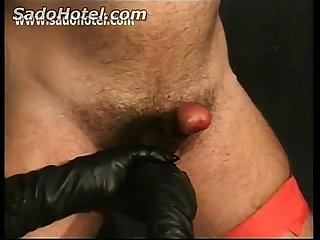 Slave gets his balls tied up and gets hit in it by dominatrix