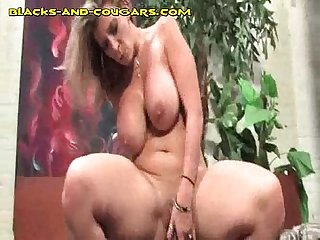 Blonde cougar rides giant black cock