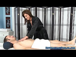Busty masseuse sucks cock