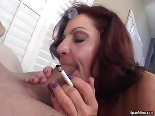 Smoking granny shows her sucking skills