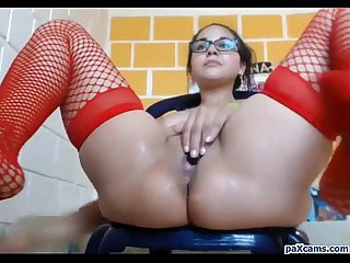 Nerdy latina in fishnet stockings squirts live on cam