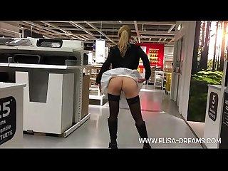 Blonde girl flashing in public shop