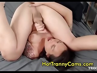 Tattooed tranny sucks her own cock while fingering her asshole and cums in her mouth