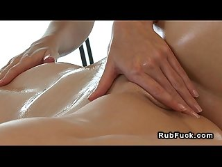 Brunette gets pussy massage with hot stones