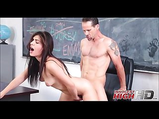 Two high school girls take turns with teacher