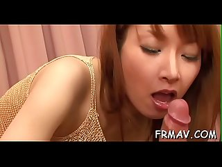 Charming japanese playgirl tames a thick pecker with oral-service