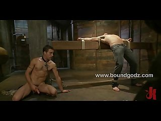 Logan Scott gets bound in metal bondage