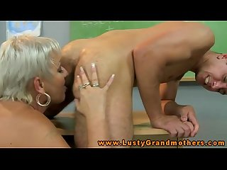 Horny gilf teacher bouncing on students dick