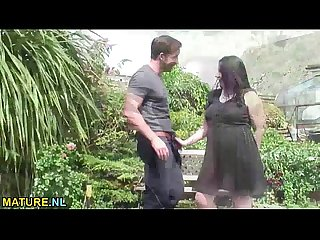 Mature lady having sex with a young stud in the garden