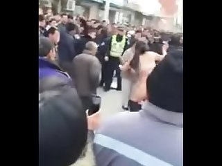 Chinese woman put off her pants fighting with cops