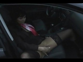 Mature babe masturbating in car