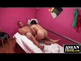 Asian masseuse rides hard dick