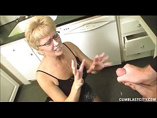 Short haired grandma gets a big facial