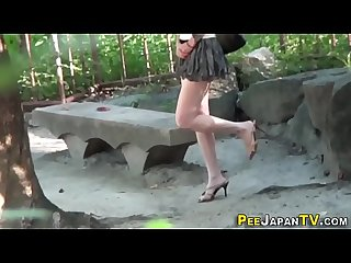 Asian babe pees outdoors