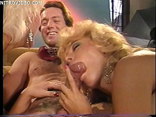 Jeanna fine and Nina hartley both sucking a guys cock