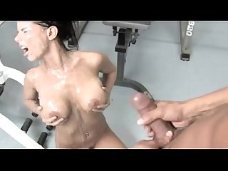 Brunette milf receives a tremendous cum load in the gym