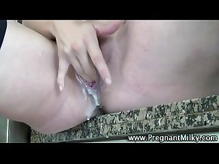 Pregnant fetish slut toying