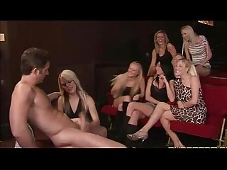 CFNM crowd enjoy the wanking of a naked guy in a small theatre