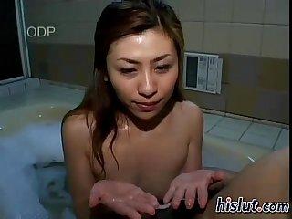 Japanese slut sucks a dick in the bathtub