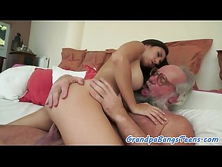 Busty young babe pleasing oldmans cock
