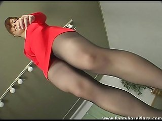 A very teasing dance by upskirt lady in pantyhose