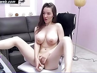 Busty amateur model Bridgette playing with a dildo