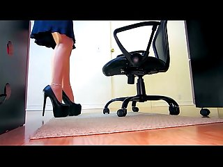 Femdom uses her pantyhose legs to squeeze tight