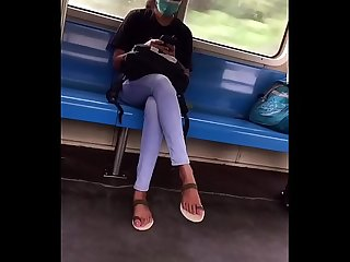 Young girl crossed legs in the train