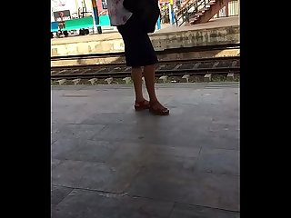 Hot legs in skirt waiting for train