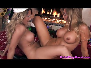 Pierced busty lesbian scissors at fireplace