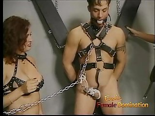 Horny stud enjoys having his throbbing boner tied up by two sluts