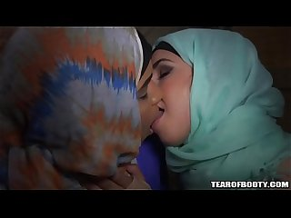 Two Arab babes kissing