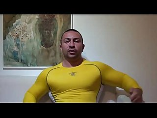 Big muscles flexing under compression spandex